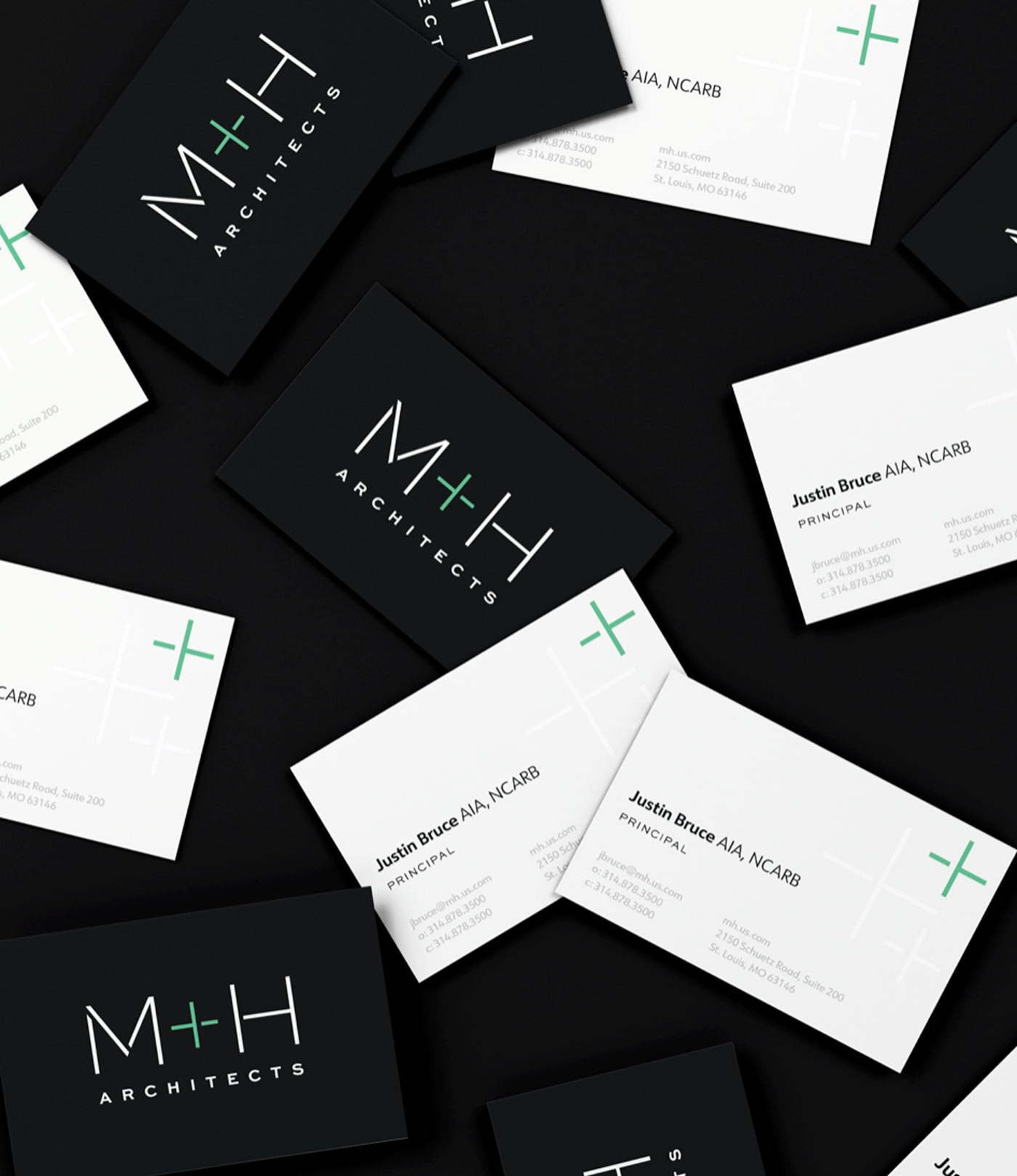 Business cards showing the new M+H Architects brand identity